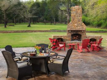 """The back paito at Hilltop Manor is a wonderful place to relax by the fire or even say your """"I Do's""""!"""