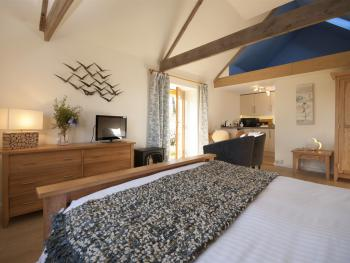 The contemporary but comfortable style retain and echoes the Tamar Orchard Barn history