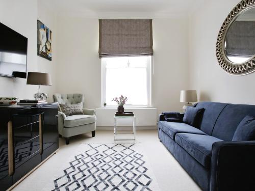 Regency high ceilings and large windows define the look of this luxury flat
