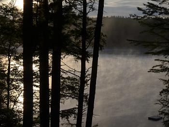 the mist rising from the lake in the morning is spectacular
