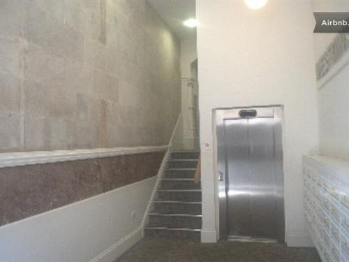 Lift and stairs for access to apartment.