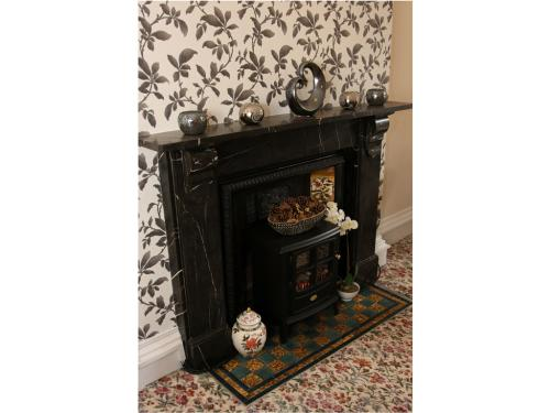 Although contemporary styled, our guest house retains many original features like this traditional fireplace.