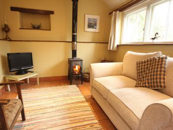 The Wheelwrights sitting room with cosy woodburning stove