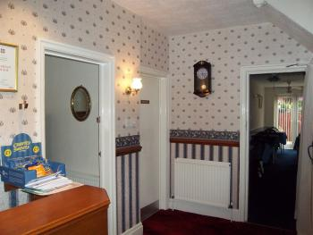Reception area and entrance to Ground floor bedroom & dining room also stairs to other floors