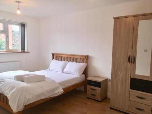 Double bed bedroom with shared bathroom