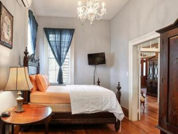 The Cypress is another two room suite with sitting room. It has a queen bed and a private bath with whirlpool, above bowl vanity, and walk in spa shower with in wall body jets