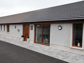 Outside view of dining room, reception area and bedrooms