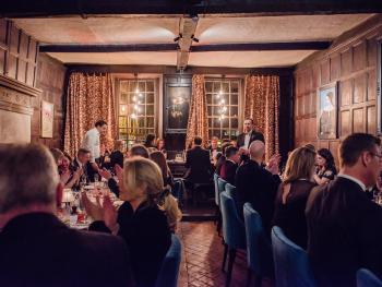 Impressive oak panelled dining hall dated 1658