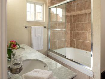 Chestnut chalets master bathroom with deep jetted and double vanity.