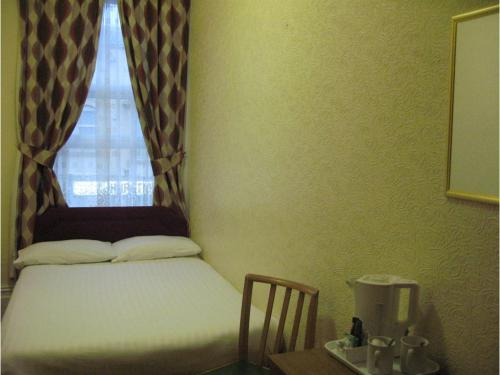 Double bedroom (Free WIFI) - comprising double bed with ensuite bathroom, courtesy tea/coffee tray, freeview tv.