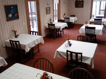 Large dining room with couples' tables