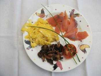 Smoked salmon and scrambled egg with eggs from our chickens and garnished with chives from the garden