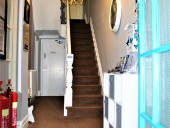 hallway and stairs to guest accommodation