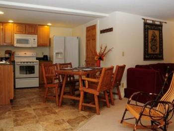 """""""Santanoni has an open kitchen-dining room-living room with a master bedroom and a 2nd smaller bedroom"""