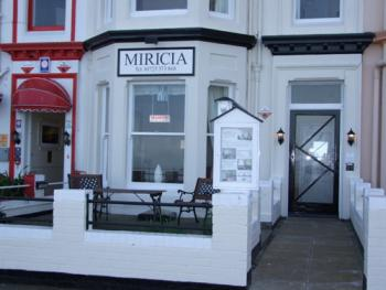 Miricia - Our Guest House and seating area with views of the North Bay beach