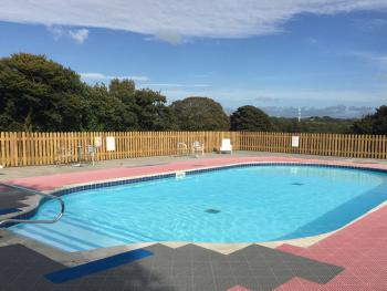 Our beautiful outdoor heated salt water swimming pool has lovely views across the open countryside