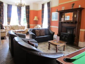 Guest lounge with real fire, pool table, TV & bar