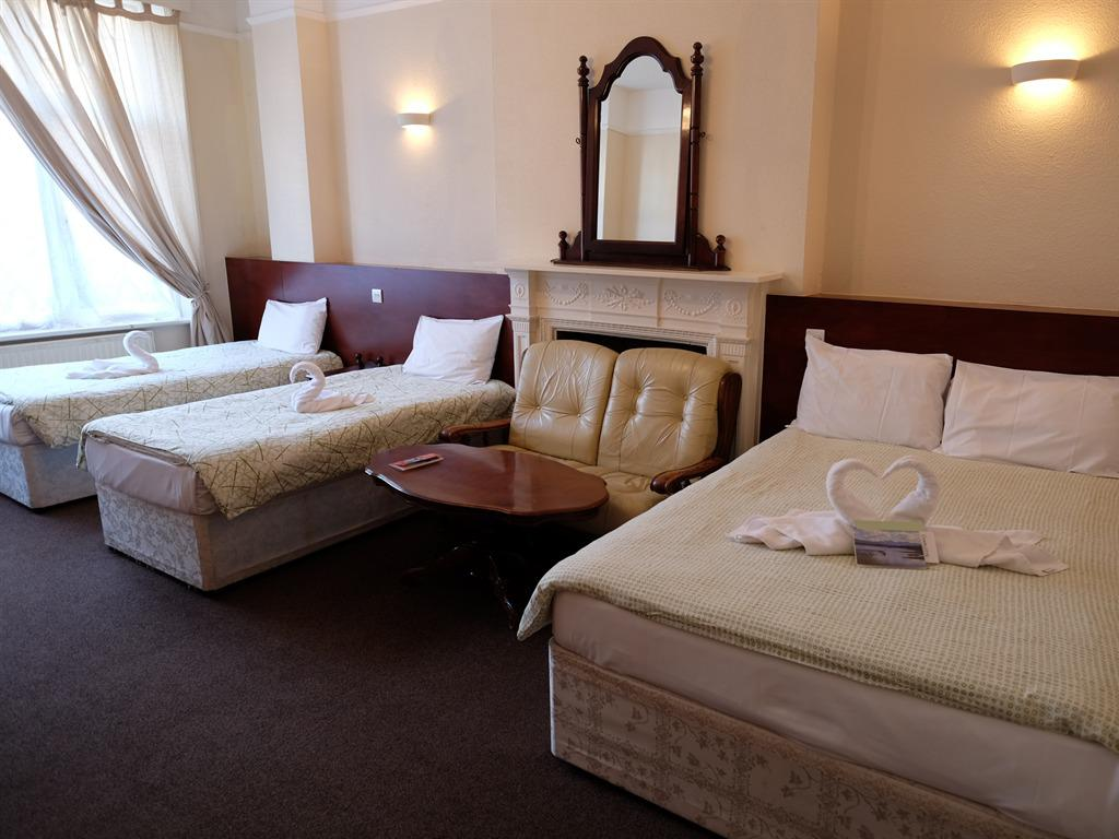 Quad room-Shared Bathroom-Double and Two Single Bed