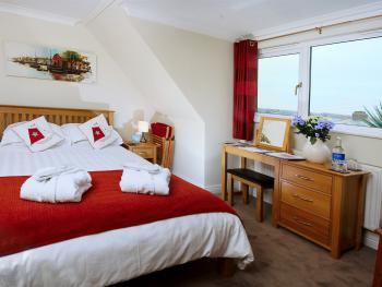 The New Padstow room with en suite shower room and king size double bed