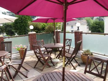 Enjoy a drink from the bar by our outdoor pool