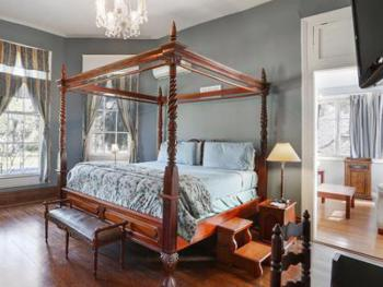 The Oak room is a two room suite that has a view of City Park