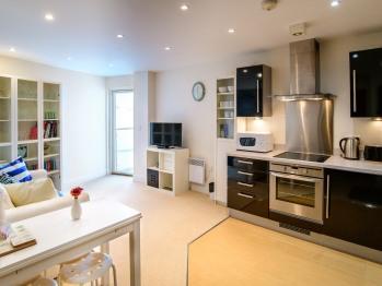 Ocean Breeze Apartment - Kitchen / Living area