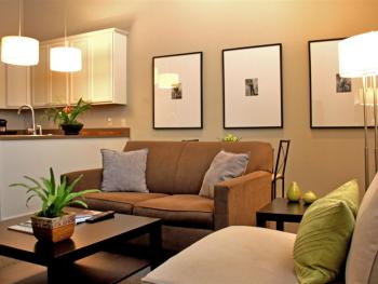 Living Room + Kitchen View - Deluxe Queen Suite (Upstairs)