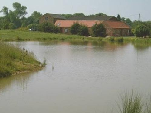 A view of Glebe Farm Aparments from the lake