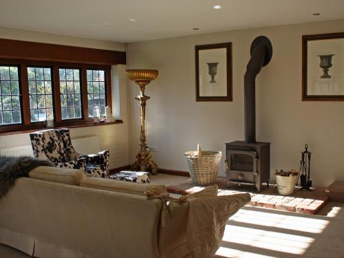 Wood burning stove in our dining/drawing room