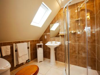 Rock room en suite shower room with powerful shower and under floor heating