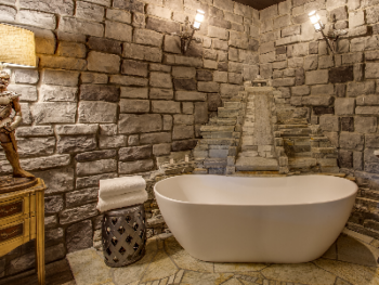 Castle Suite soaking tub with custom stone
