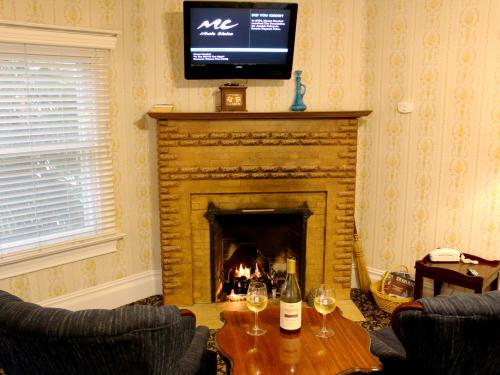 Relax with some wine and a movie in front of your fireplace in the Master.