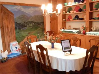 Small dining room with painted mural