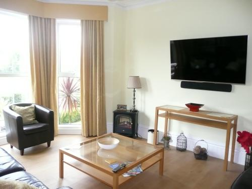 Large comfortable loungs with bay window and views across the park