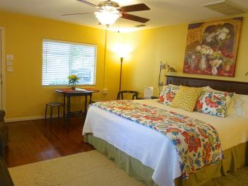 Cypress Room with king bed & dine-in table