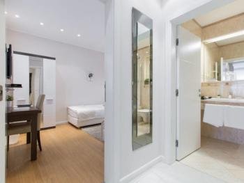 The Superior One Bedroom Suite has an additional bedroom with 2 single beds