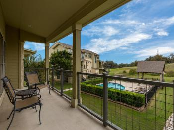 Private balcony off of the dining room.  Great views of the pool, golf course and Hill Country.