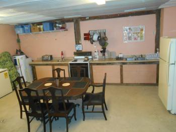 Self-catering kitchen and dining area on first floor.