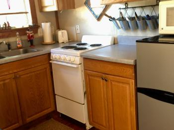 Kitchen in Michelle's Log Cabin.  All 4 cabins at the 9E Ranch have full kitchens with pots, pans, dishes.