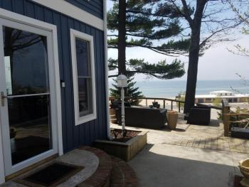 Front entrance and view of deck and Lake Michigan