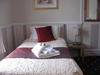 This is room 3, a smaller room would suit a single person or couple.Again with ensuite,tea/coffee facilities Colour TV