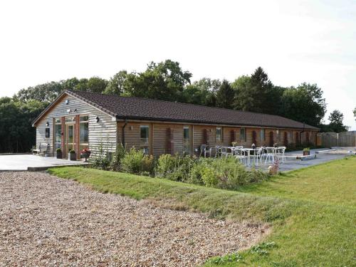 Car park, grassed and decked area. Views over farmland and surrounding countryside.