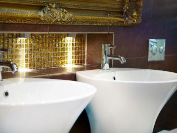 Dual sinks, heated mirrors and beautiful French porcelain tiles