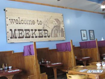 The old Welcome To Meeker Sign now hangs in our Café next door.