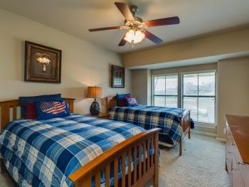 2nd Bedroom, located upstairs where you can enjoy views of the pool and golf course.