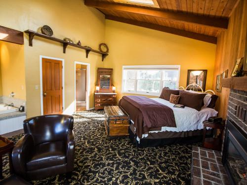 The Enchanted Rose with vaulted redwood ceilings, in-room spa tub, fireplace, wet bar and private bath.