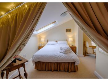 King sized bed with bath and separate shower room. Photography by Andrew@onelocationcreative.co.uk