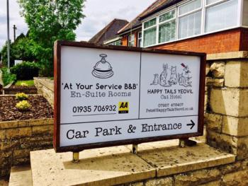 At Your Service B&B - Entrance to a large free on site car park at the rear of the property
