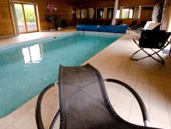 Relax in our pool rocking chairs and drift off to sleep by the indoor heated swimming pool