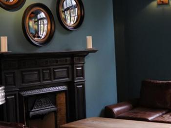 One of the fireplaces in the bar